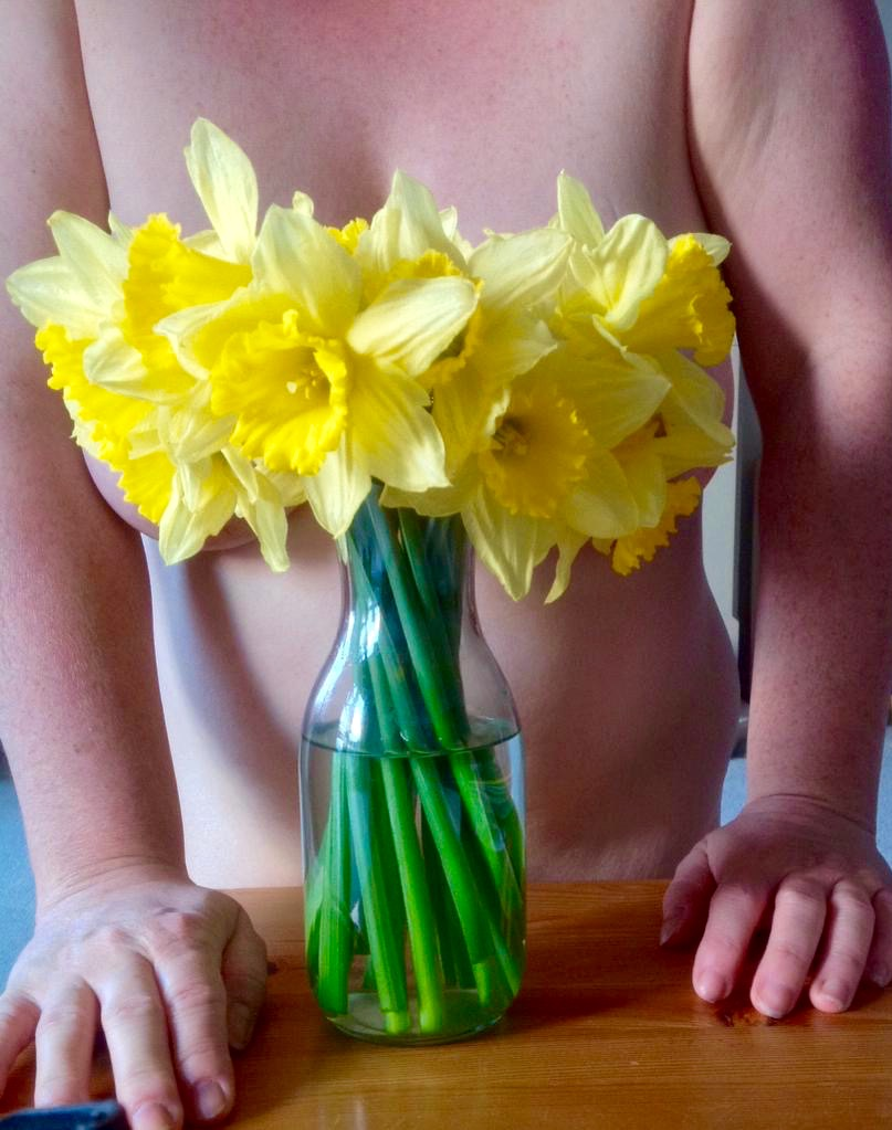 sexy lady with saffodils - spring has sprung