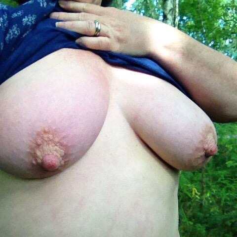 woman with large breasts flashing woodland boobs