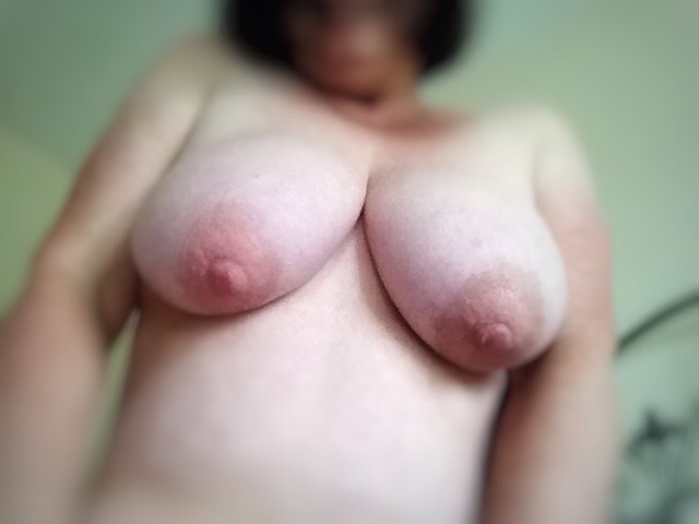 blurred image of sexy woman with large breasts