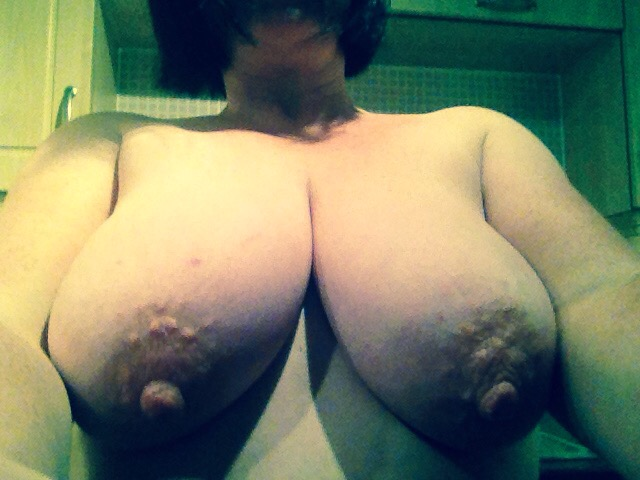 Huge breasts on sexy hotwife doing naked housework
