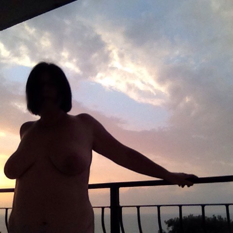 lady naked on balcony at sunrise