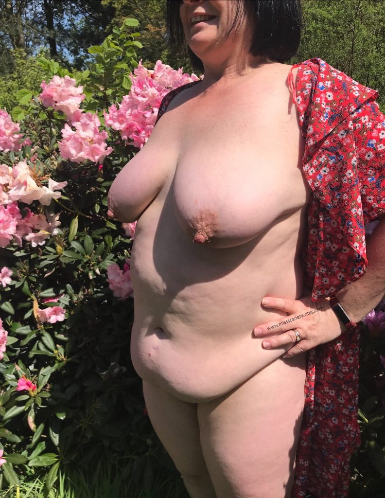 Curvy lady by rhododendrons